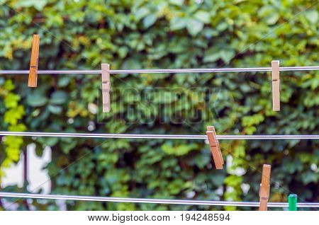 clothespins on a plastic rope with blurred background