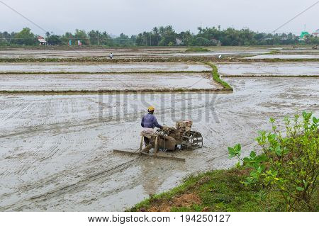 Man Is Working The Soil By Manual Motor Cultivator In Rural Region, Vietnam