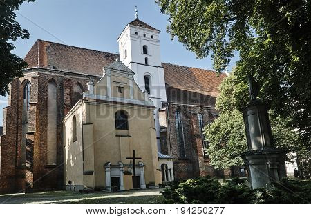 Gothic Catholic church with baroque chapel in Poznan