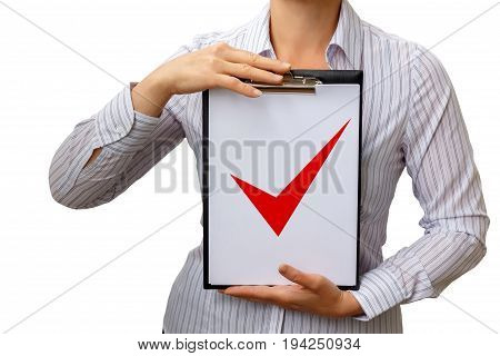 A Check List With A Check Mark In The Hands Of Businesswoman .