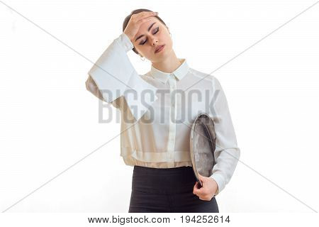 tired waitress kept the ball for a head isolated on white background