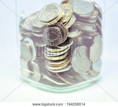 Close up of coins in a jar