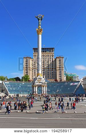KYIV, UKRAINE - MAY 01, 2017:People walk take pictures and relax in front of Independence Monument with the Statue of Berehynia at the top Maidan Nezalezhnosti, Independence Square