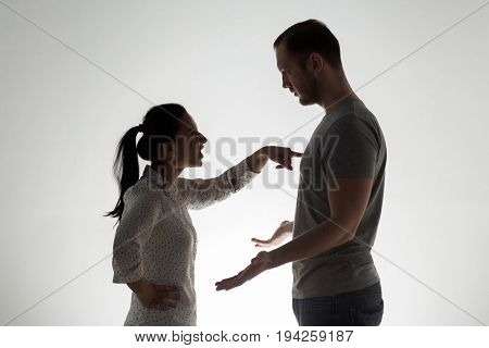 people, relationship difficulties, conflict and family concept - angry couple having argument