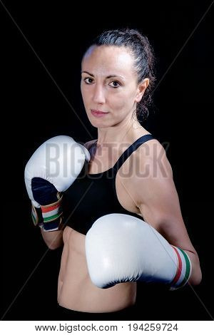 Athlete boxer woman busty portrait artificial lighting.