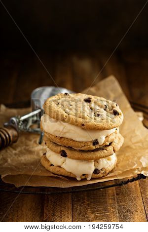 Ice cream sandwiches with nuts and caramel and chocolate chip cookies