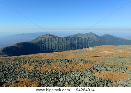 Mount Jefferson (left), Mount Adams (middle), and Mount Madison (right) in fall with foliage from summit of Mount Washington, White Mountains, New Hampshire, USA.