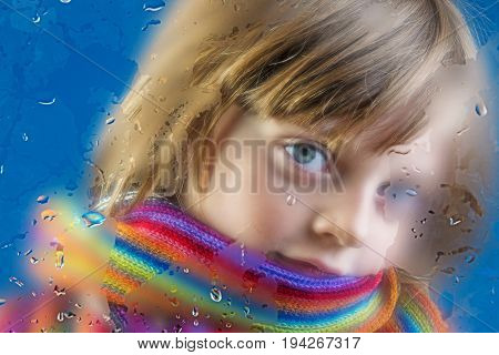 rainy - a little girl behind a dewy window