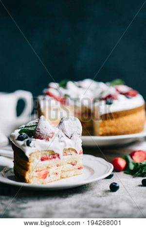 Strawberry sponge cake on a white plate