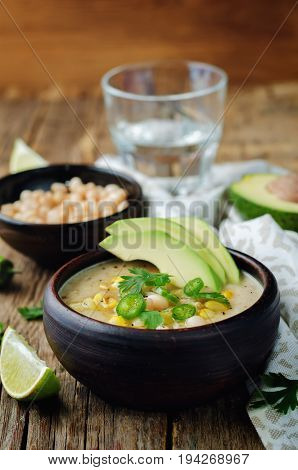 White bean chicken chili on a wood background