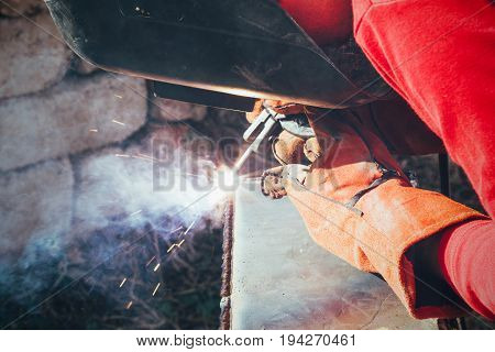 a welder puts the seam on the metal electro arc welding