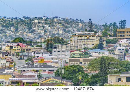 Elegant neighborhood and favela hill view of Guayaquil city Ecuador