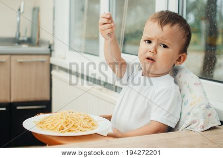 A Child With A Fork, Won't Eat Pasta