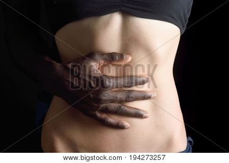 A man's hand caressing a woman's belly