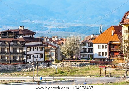 Bansko, Bulgaria spring view with trees, mountains landscape and houses