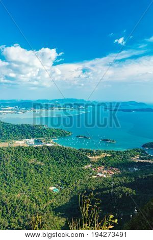 View of blue sky sea and mountain seen from Cable Car viewpoint, Langkawi, Malaysia. Picturesque landscape with town among the tropical forest beaches small Islands in waters of Strait of Malacca