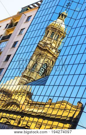 Reflection of the Cathedral of Santiago tower in the windows of the modern building at Plaza de Armas in Santiago, Chile