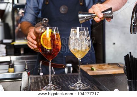 Barman At Work, Preparing Cocktails. Concept About Service And Beverages In The Kitchen The Restaura