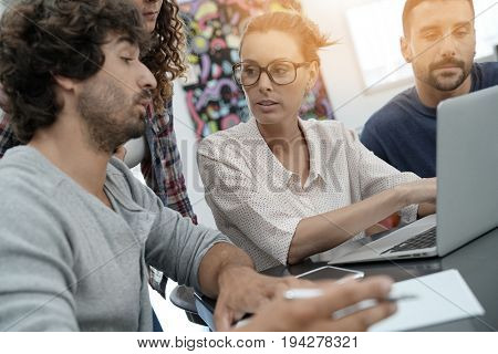 Young people meeting with laptop computer