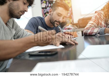 University students filling in application form