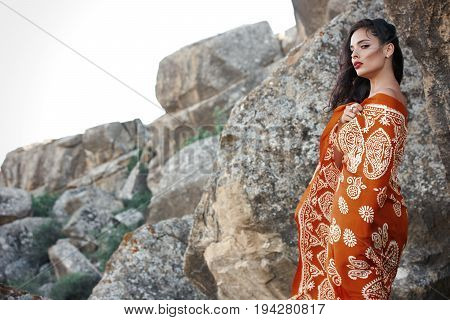 Portrait of a beautiful oriental look young woman with colorful oriental scarf