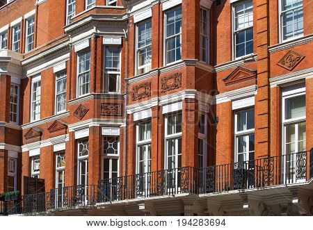 London, UK - September 8, 2016: Windows of the luxury apartments in Mayfair. Centre London residential buildings.  Kensington church street.