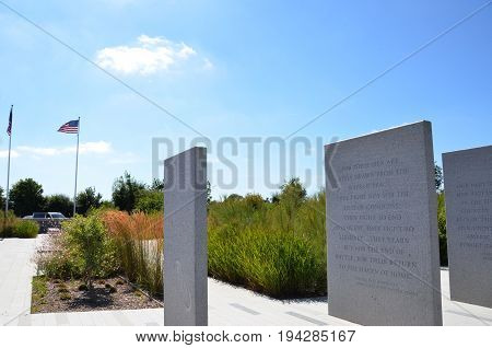 COLLEVILLE-SUR-MER FRANCE - AUG 12: A Franklin Roosevelt quote at the Normandy American Cemetery and Memorial in Colleville-Sur-Mer France is shown on August 12 2016.