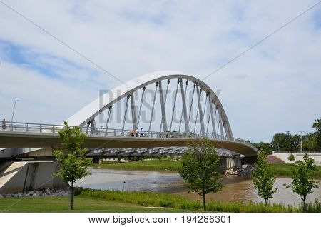 COLUMBUS OH - JUNE 28: Main Street Inclined Arch Suspension Bridgeat Bicentennial Park is shown on June 28 2017. It was designed by Dr. Spiro Pollalis.