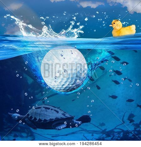 Golf ball splashes into blue water with wildlife.