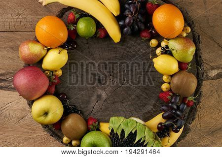 Top view of a huge group of fresh vegetables and fruit on wooden background with copy space. Vegetables VS Fruit - High quality studio shot