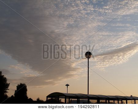 Urban scene silhouetted against a dramatic summer dusk sky with Altocumulus clouds