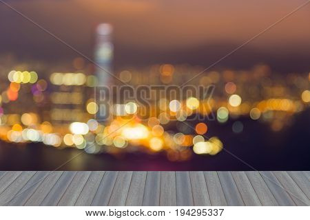 Opening wooden floor City of Hong Kong burred bokeh light night view over Victoria Bay abstract background