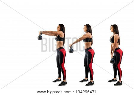 Slender brunette woman doing exhalation with weight on biceps on white isolated background view from left side stage exercises on biceps