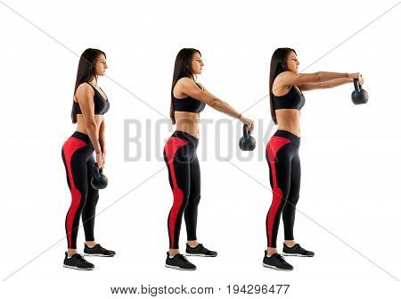 Slender brunette woman doing exhalation with weight on biceps on white isolated background view from right side stage of biceps exercise