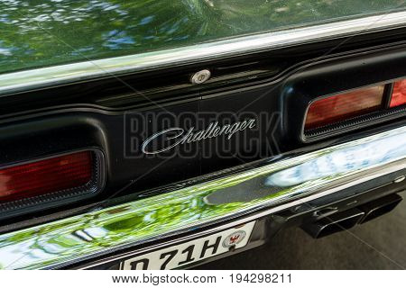 BERLIN - JUNE 17 2017: Emblem of a muscle car Dodge Challenger R/T coupe 1970. Classic Days Berlin 2017.