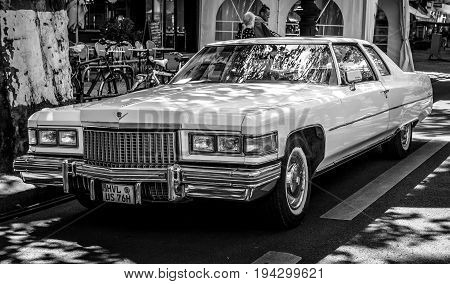 BERLIN - JUNE 17 2017: Full-size luxury car Cadillac Coupe de Ville (fourth generation) 1975. Black and white. Classic Days Berlin 2017.