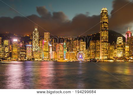 Sea front Hong Kong city blurred bokeh light central business downtown building abstract background