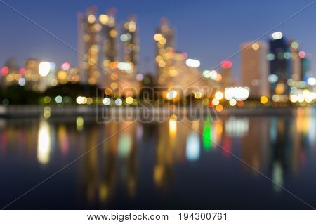 Beauty blurred bokeh light with water reflection at twilight abstract background
