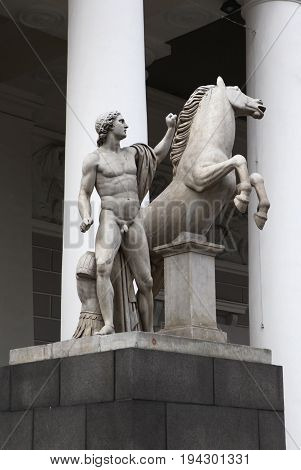 St. Petersburg, March 3, 2016 - An antique statue - a naked young man with a horse near the Horse-riding arena in St. Petersburg, Russia