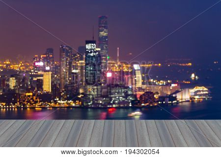 Opening wooden floor Night city light blurred bokeh light aerial view Hong Kong city abstract background