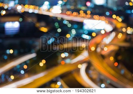 Aerial view Highway intersection blurred bokeh light night view abstract background