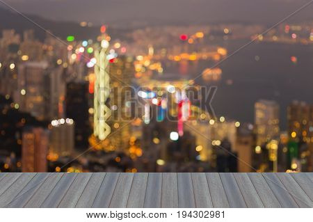 Opening wooden floor Central city business downtown blurred bokeh light aerial view Hong Kong abstract background