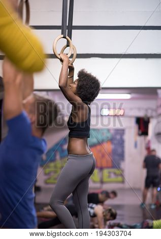 Fitness dip ring beautiful young african american woman workout at gym dipping exercise