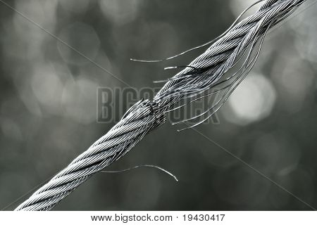 Breaking steel cable