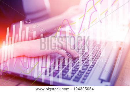 Double exposure stock financial on hand of business woman typing on keyboard. Financial stock market economy analysis. Business people and Economy financial concept.