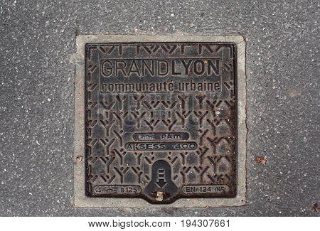 Lyon, France - December 20, 2016: Gas of France - a metal hatch on the asphalt in December 20 in Lyon, France