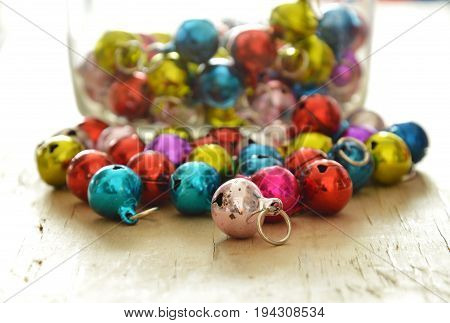 colorful bells rolling on the wooden board