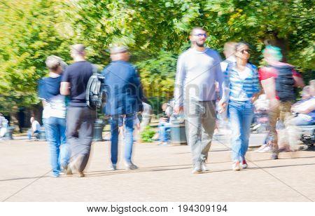 London, UK - September 8, 2016:  Blurred image of walking people in the park