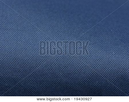 Blue outdoor gear polyester fabric close up with depth.