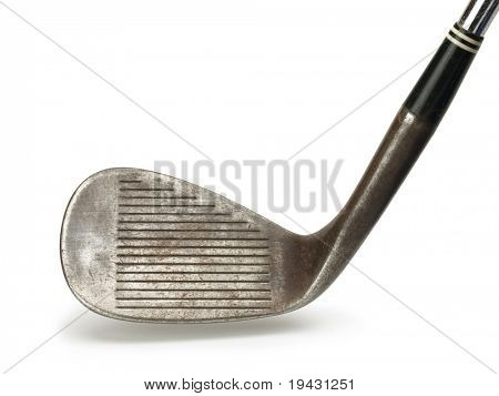Old golf club. head section of a old forged raw iron wedge, with natural shadow.
